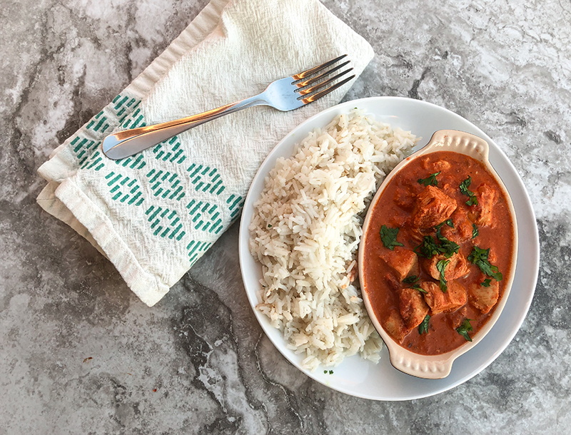 Chicken Tikka Masala with basmati rice and napkin and fork